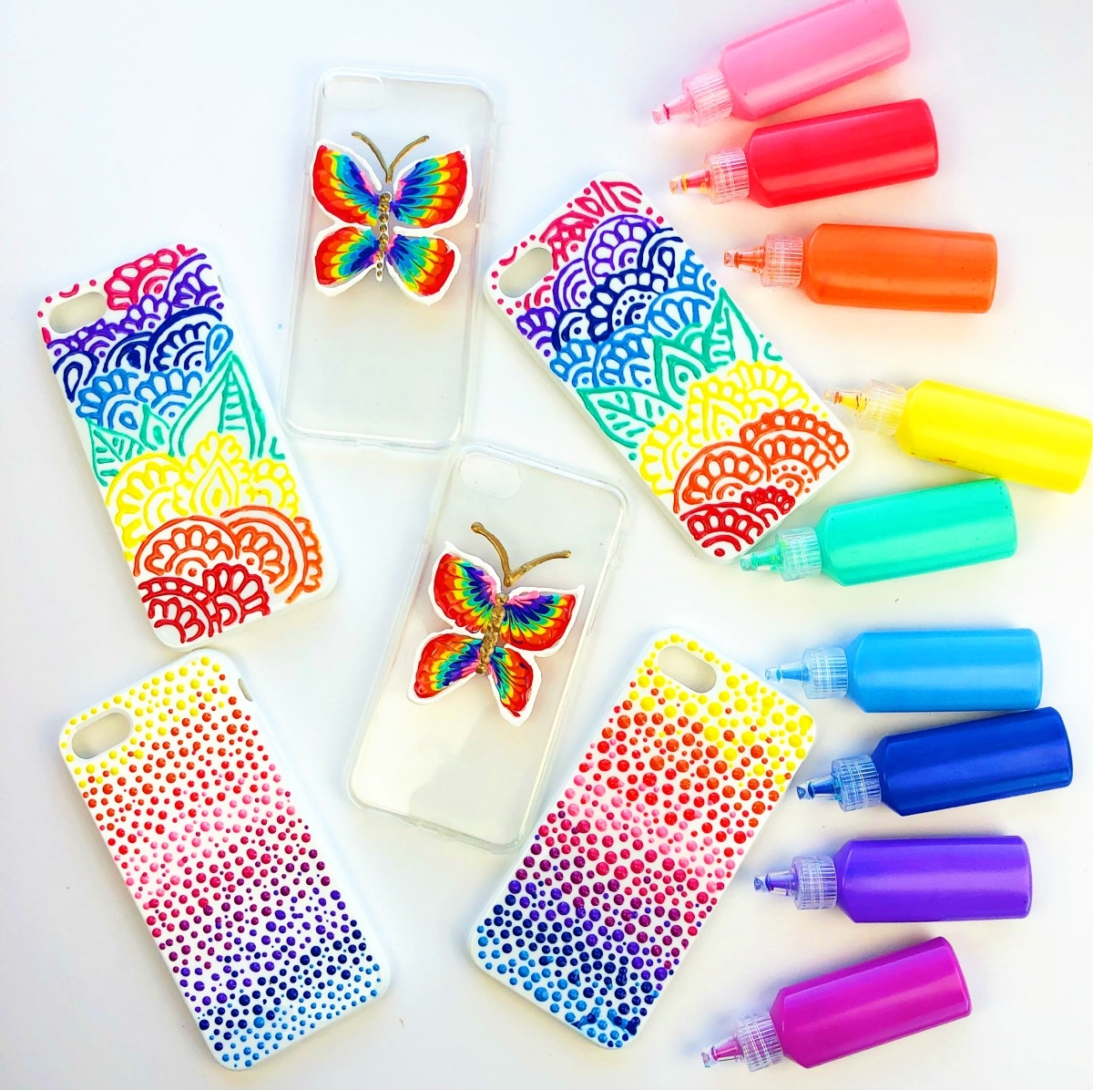 Variety of Dimensional Fabric Paint decorated phone cases