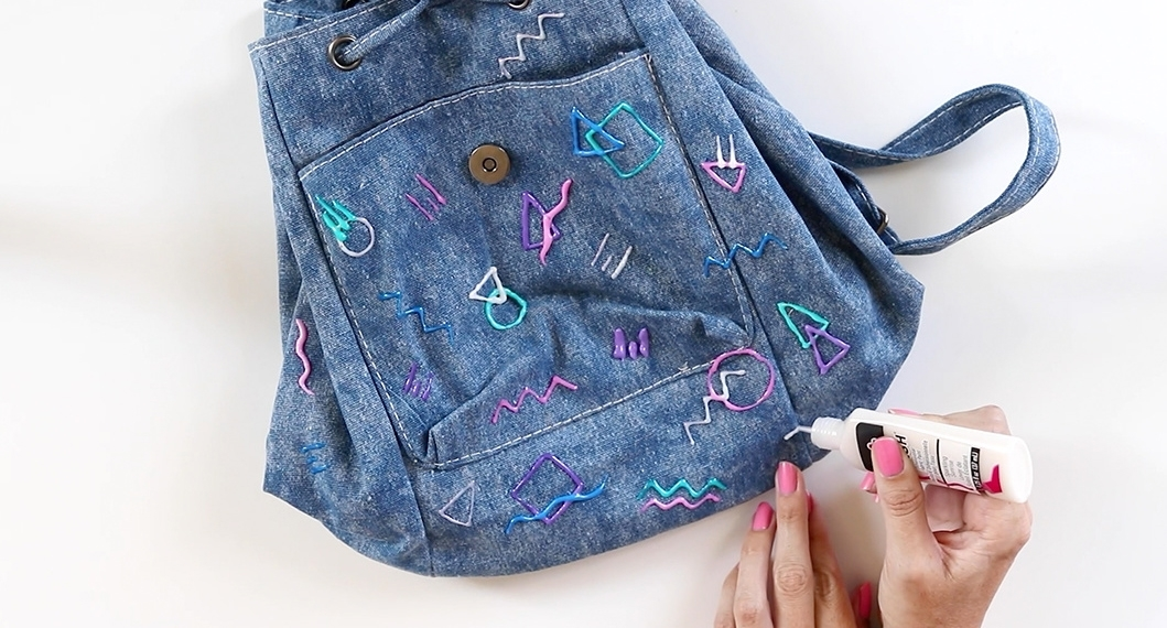 Tulip 80s-Inspired Denim Backpack - apply dimensional paint