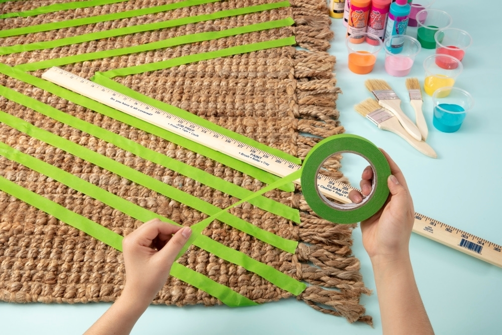 Use painter's tape and a ruler to mask off stripes