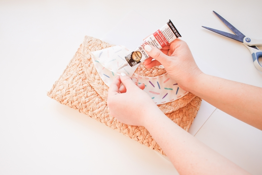 Glue donut fabric onto clutch