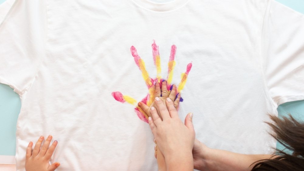 Paint child's hand and press onto shirt