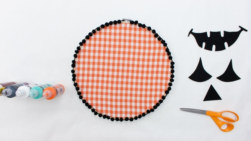 Cut and secure fabric between hoops