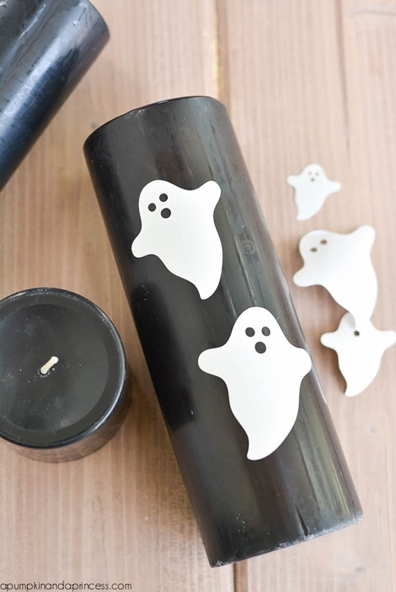 Create design onto candles with vinyl or freehand