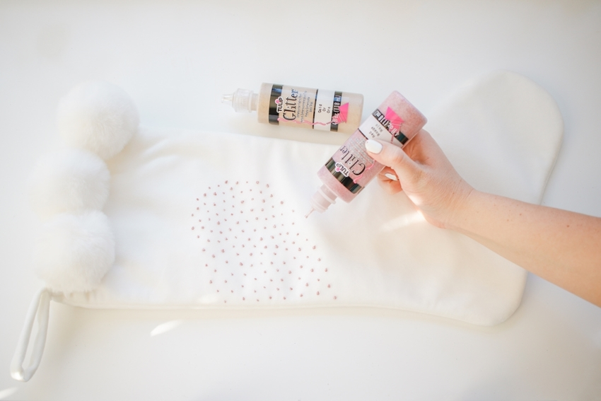 Squeeze dots of paint onto stocking