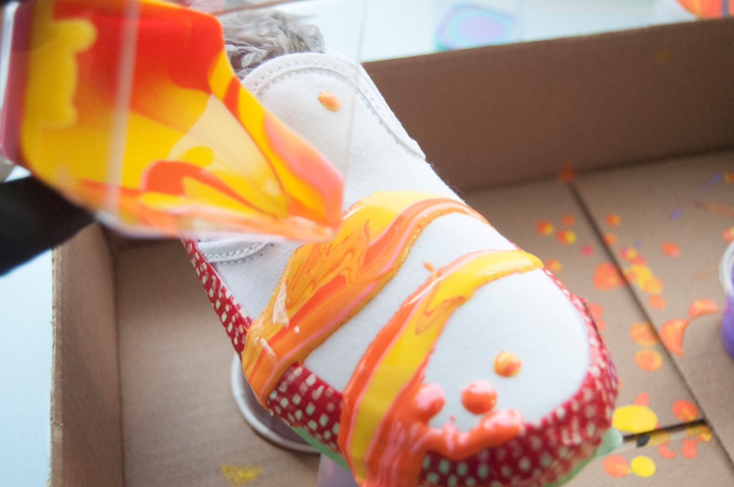 Place shoes in box and begin paint pouring