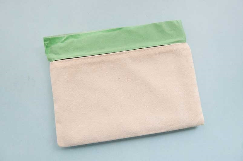 Place cardboard into pouch and tape off zipper