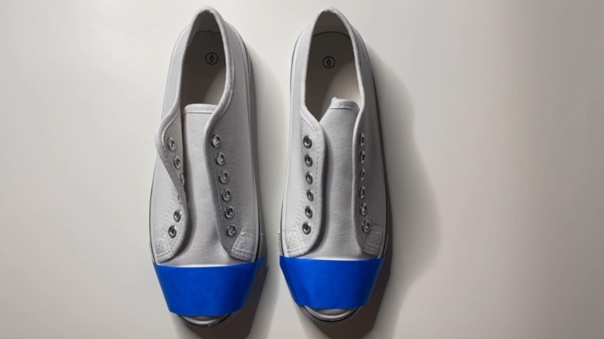 Tape off areas of shoes you don't want paint on