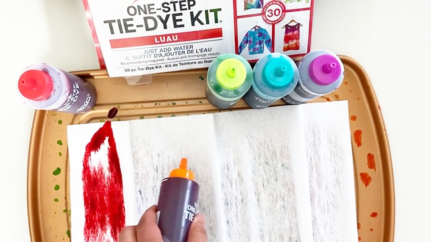 Apply dyes to damp crepe paper