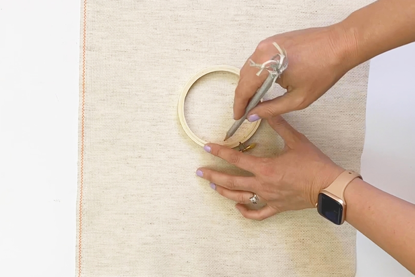 Trace embroidery hoops on cloth
