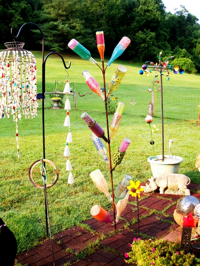 Painted bottle trees by Abigail Reeves