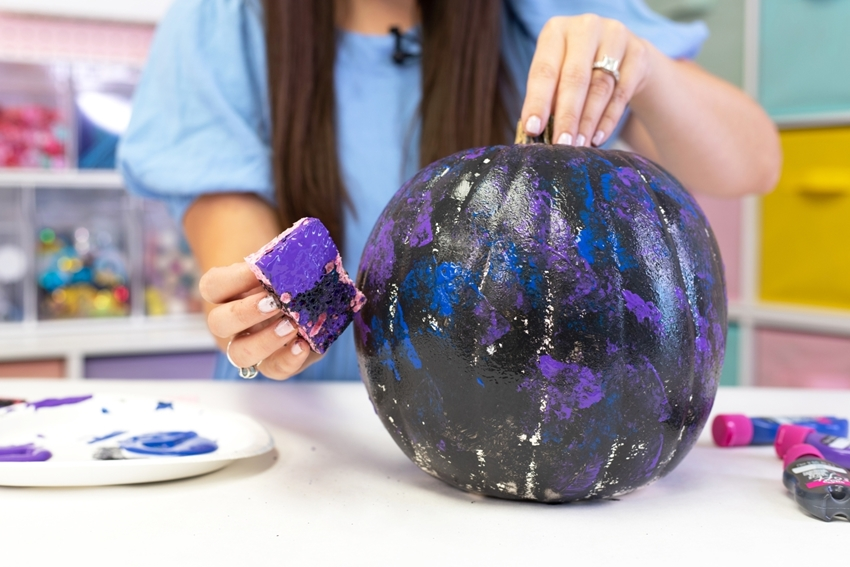 Paint a basecoat of black then dab on other colors