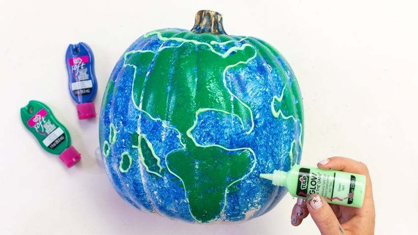 Outline continents with Green Glow Paint