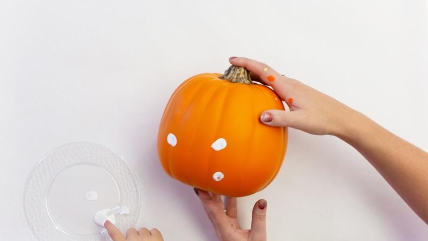 Press white paint around pumpkin for ghosts