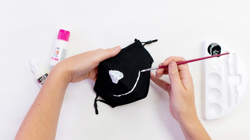 Use fabric paint to decorate your skeleton mask
